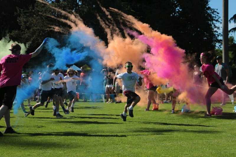 PHOTO COURTESY OF THE CITY OF TUALATIN - Kids run through a 'color bomb' station at Tualatin's fun, messy Blender Dash on Saturday., Times - News  Tualatin's first Blender Dash a 'great success'