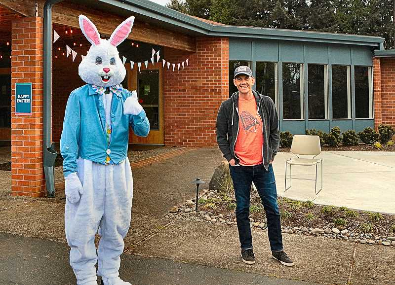 DAVID F. ASHTON - Standing at a safe social distance from each other, the Easter Bunny joins Hope City Church Lead Pastor Brian Becker as the Drive-through Easter Egg Hunt begins.
