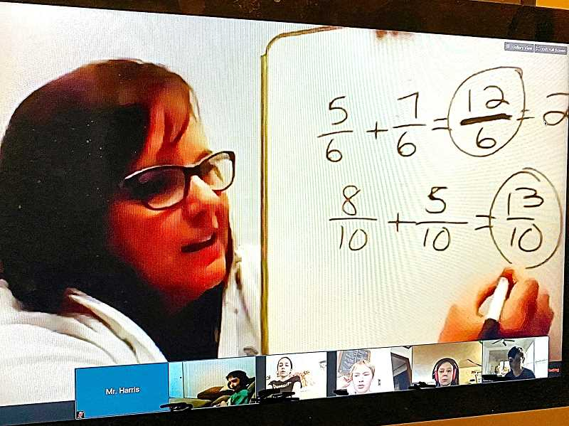 CONTRIBUTED PHOTO -  St. Agatha Catholic School 4th grade teacher Laurie Johnsen provides a math lesson via live video conference with her students.