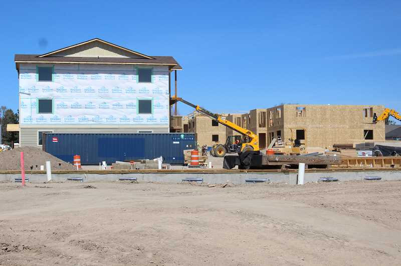 JASON CHANEY - A large apartment complex is under construction and will add more than 150 units to the local housing market once it is completed.