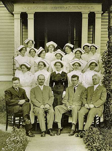 COURTESY SMILE HISTORY COMMITTEE - This is a formal photo of the staff and nurses of the Sellwood Hospital, in its early years. Dr. John J. Sellwood is seated to the far right, and Dr. John Besson is to his left (with the dark tie). The woman in the dark uniform might be Miss Sharp, who was the Superintendent of the hospital in 1914. Sellwood residents were relieved to have a hospital so close by; it saved them from having to go downtown or to Oregon City when they needed emergency medical care.