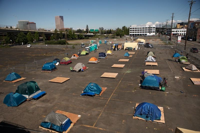 PMG PHOTO: JAIME VALDEZ - There were about 20 tents pitched at a new outdoor homeless shelter on Southeast Water Avenue at Main Street in Portland on Monday, April 20.