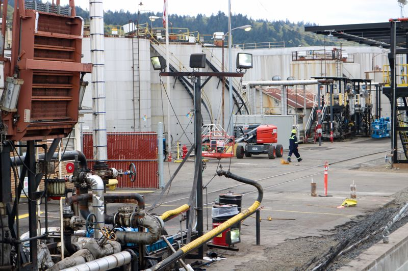 PMG PHOTO: ZANE SPARLING - A Zenith Energy worker strolls through the company's terminal in Portland.