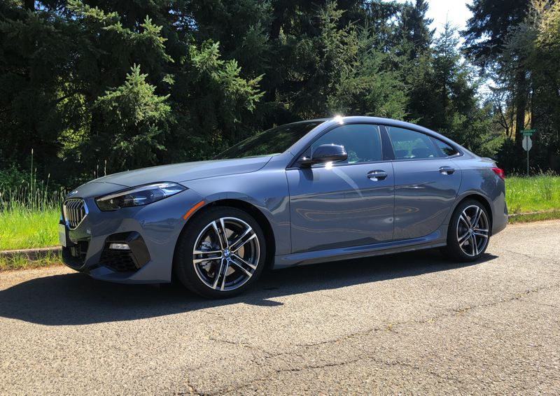 PMG PHOTO: ,JEFF ZURSCHMEIDE - BMW calls this model a Gran Coupe because of the slope of the rear roofline and the short trunk area in the back. But you still get four doors, so it's more of a coupe-like sedan.