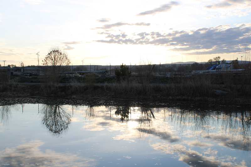 TERESA JACKSON/MADRAS PIONEER - The sun rose over an almost-full fishing pond at the Jefferson County Fairgrounds Tuesday, April 21. The county wasn't planning to fill the pond due to a lack of water, but the city of Madras offered to temporarily transfer water rights so the pond could be filled.