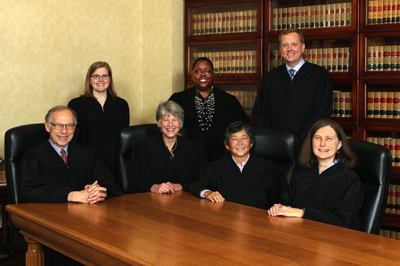 COURTESY OREGON JUDICIAL DEPARTMENT - Oregon Supreme Court justices. Seated from left: Thomas Balmer, Chief Justice Martha Walters, Lynn Nakamoto, Meagan Flynn. Standing: Rebecca Duncan, Adrienne Nelson, Chris Garrett. The court upheld Oregon's paid sick-leave law in a decision announced Thursday, April 23.
