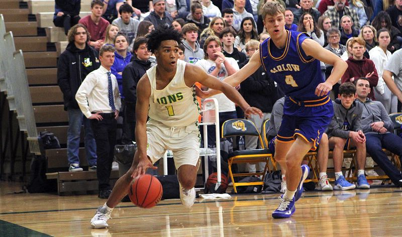 PMG PHOTO: MILES VANCE - West Linn senior guard Micah Garrett was named to the Class 6A all-state second team this year after leading the Lions to a berth in the state tournament.