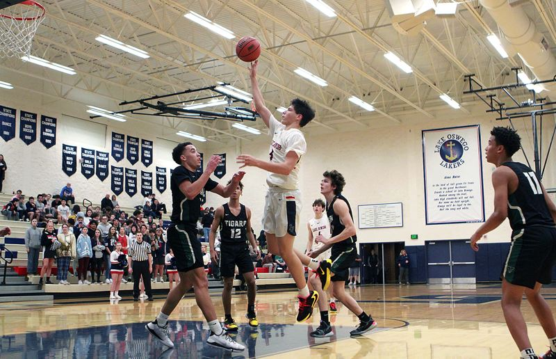 PMG PHOTO: MILES VANCE - Lake Oswego senior guard Casey Graver won a place on the Class 6A all-state honorable mention team after leading the Lakers to a Three Rivers League championship and a state tournament berth.
