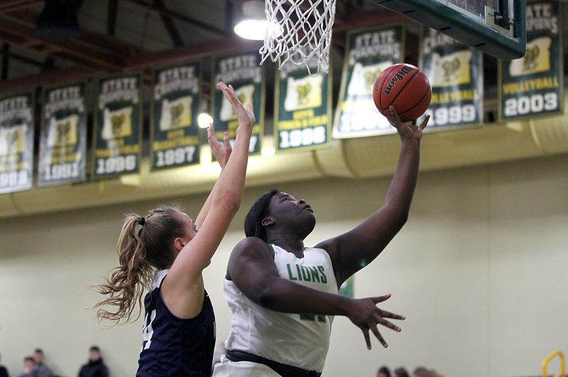 PMG PHOTO: MILES VANCE - West Linn junior post Aaronette Vonleh was named to the Class 6A all-state first team after leading the Lions to a Three RIvers League championship and winning TRL Player of the Year honors.