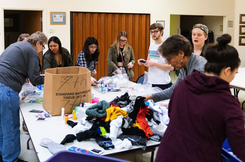 PMG PHOTO: CHRISTOPHER OERTELL - Volunteers sort through donated supplies during a trial run for winter shelter volunteers at Emanuel Lutheran Church in Cornelius on Wednesday, Nov. 13, 2019.