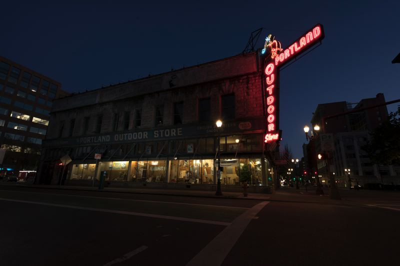 PAMPLIN MEDIA GROUP: JAIME VALDEZ - The neon sign still works, despite its peeling paint. The same can be said for the rest ot the Portland Outdoor Store, which sells work western clothing, althougth with no online business it faces a challenge during the croonavirus shutdown.