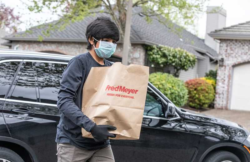 PMG PHOTO: JONATHAN HOUSE - Neel Jain makes a free grocery delivery with his organization, PDX Concierge.