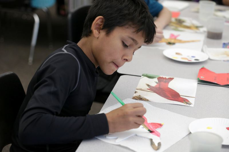PMG FILE PHOTO - A student paints a metal bird during an arts class at Charles F. Tigard Elementary School in 2016. Organizations like Tualatin Valley Creates work to nurture and develop Washington County residents' artistic talents.