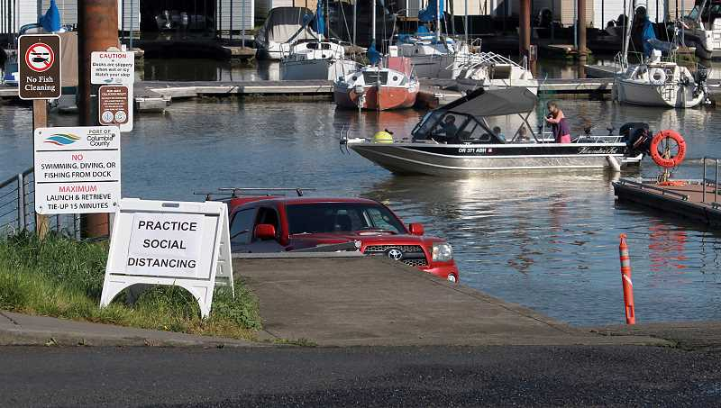PMG PHOTO: MILES VANCE - Signs posted at the Scappoose Bay Marine Park remind users to follow guidelines and take precautions to reduce the risk of viral transmission.