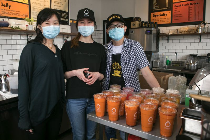 PMG PHOTO: JAIME VALDEZ - Vickie Hu, left, Bella Wang and Jerry Hu, owners of Mo Cha Tea Houses in Beaverton and Swee2o Tea & Desserts in Portland, said they are happy to provide tea and snacks for hospital workers.