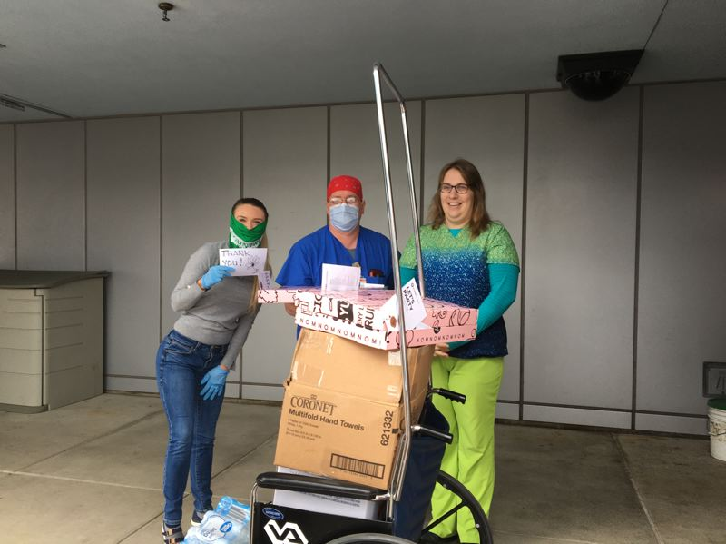 COURTESTY PHOTO - Country Financial insurance representative Gabrielle Zenner, left, who works at the Tualatin branch, makes a recent food delivery to the operating room employees at Portland Veterans Administration Medical Center.