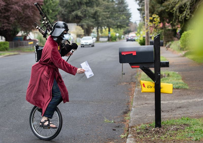 MULTNOMAH COUNTY PHOTO: MOTOYA NAKAMURA - Brian Kidd, better known as the Unipiper, wheels his way toward a Portland mailbox in order to post his mail-in ballot, which doesn't require a stamp.