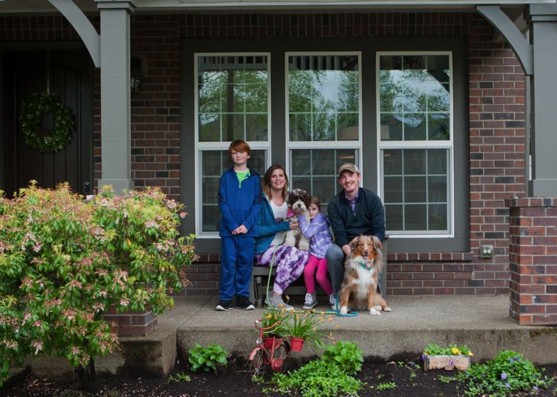 COURTESY PHOTO: VANESSA ZINKE - The family of Dave and Maegan Brooks poses for a photo through porch project conducted by Villebois resident Vanessa Zinke.