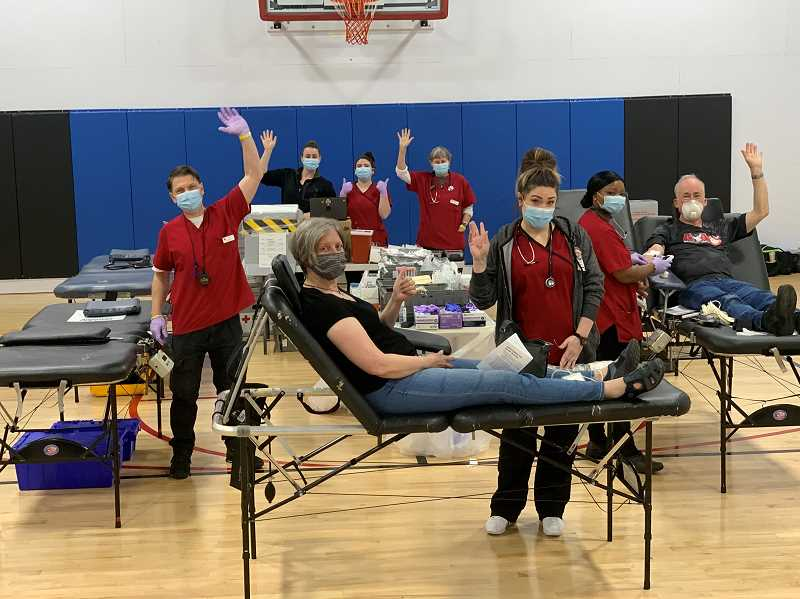 COURTESY PHOTO - Red Cross employees and blood donors gathered last year in the gym at East Side Athletic Club in Oak Grove.