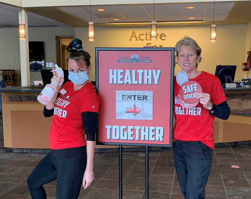 COURTESY PHOTO - Carly Langston, East Side Athletic Club's service desk ambassador (left), joins gym owner Terri Gilreath in welcoming blood donors last year.