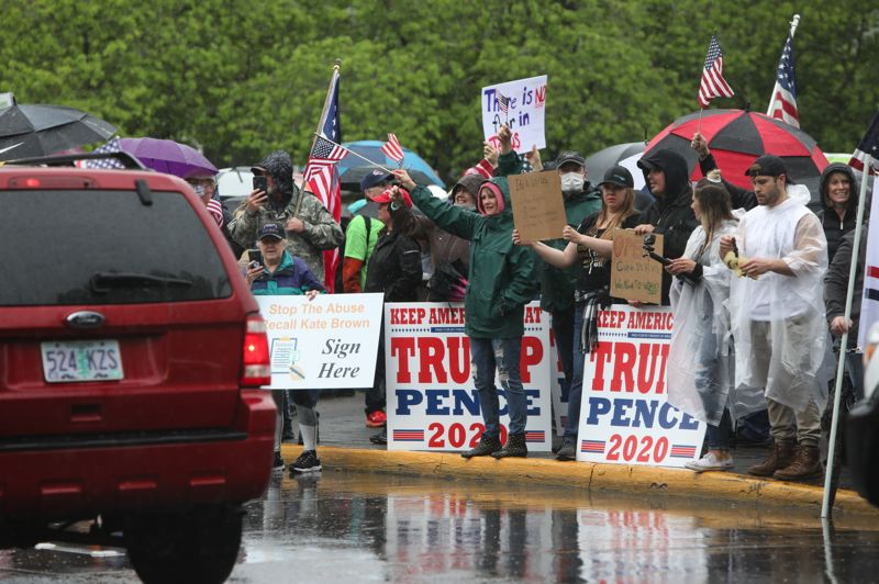 PMG PHOTO: AMANDA LOMAN - Protesters from across Oregon gathered for a 'Reopen Oregon' rally outside the Oregon State Capitol building on Saturday, May 2 in Salem.