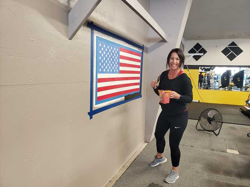 COURTESY PHOTO: MADTOWN FITNESS - Jennifer Robbins at MadTown Fitness is using the mandatory closure due to COVID-19 to paint.