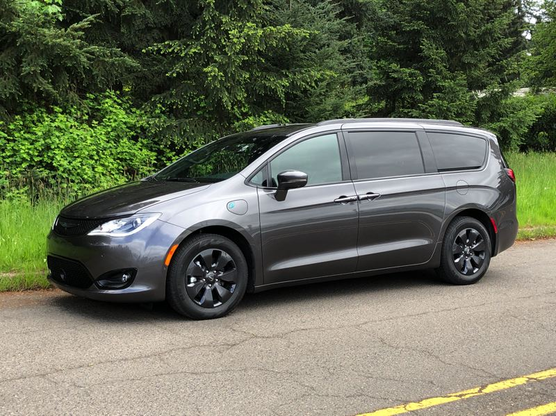 PMG PHOTOS: JEFF ZURSCHMEIDE - The 2020 Chrysler Pacifica Hybrid can carry seven people in comfort and go 30 miles on electricity alone before switching over to a gas-saving hybrid mode.