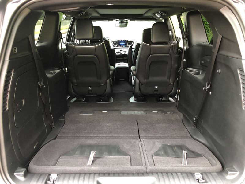 PMG PHOTO: JEFF ZURSCHMEIDE - Cargo space in the 2020 Chrysler Pacifica Hybrid is enormous with the third row seats folded flat into the floor.