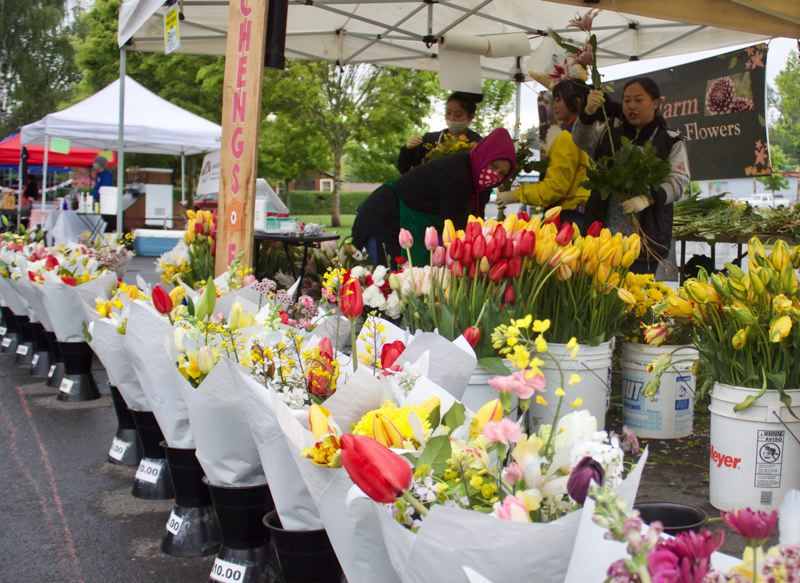 PMG PHOTO: CHRISTOPHER KEIZUR - The Gresham Farmers Market opened for the 2020 season last weekend, implementing safety measures to keep everyone safe.