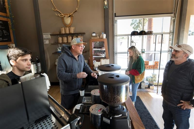 PMG PHOTO: JAIME VALDEZ - Owner Kevin Bates fills a customer's order at the Tigard Symposium Coffee shop earlier this year, before the quarantine.