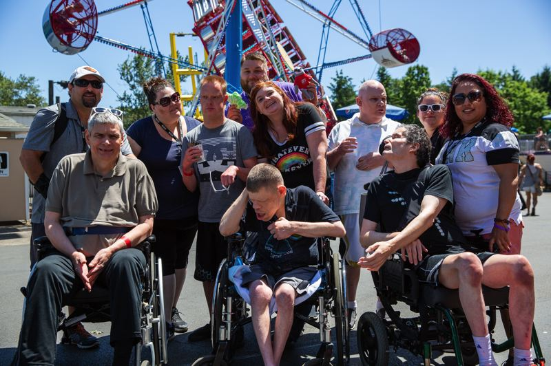 COURTESY PHOTO: ALBERTINA KERR - Clients of nonprofit Albertia Kerr enjoy a prepandeimic outing to Oaks Amusement Park. During the star-at-home orders, Kerr caregivers are getting creative, concoting other ways to have fun while staying safe.
