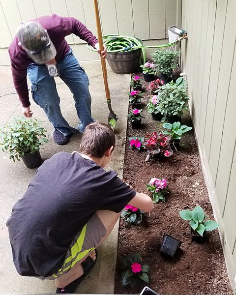COURTESY PHOTO: ALBERTINA KERR - Some Albertina Kerr clients beautify the ground with flowers.