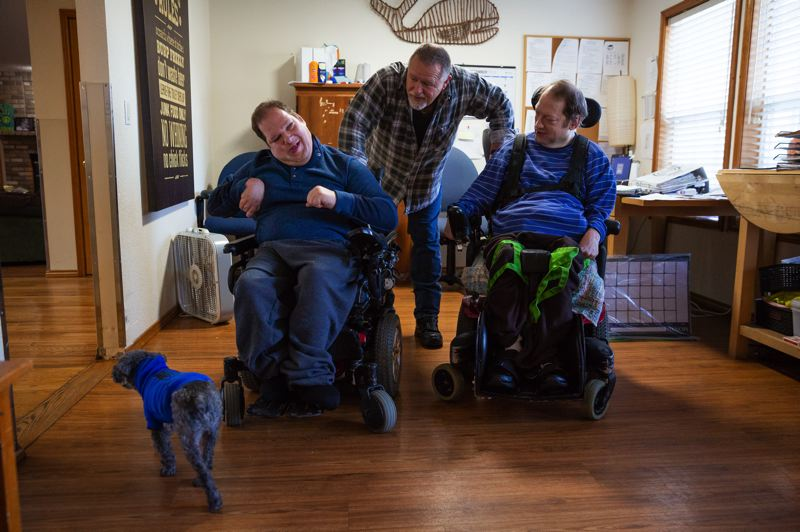 COURTESY PHOTO: ALBERTINA KERR - Craig Jantze, Ben Knowles (Kerr program manager), Mike Mordecai, and dog Justice, hang out at home, before pandemic restrictions were put in place.