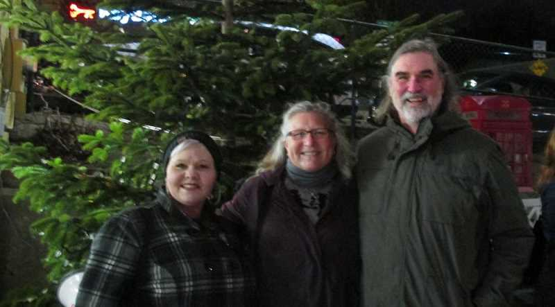 PHOTO BY BILL GALLAGHER 2018 - The artist, on the left, with Barb Cantonwine and Michael Carroll of Healthy Pets NW at the Multnomah Village Tree Lighting Gala in December 2018.