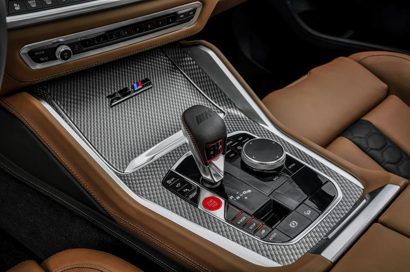 COURTESY BMW USA - The dial next to the shifter on the center console helps operate the infotainment system.