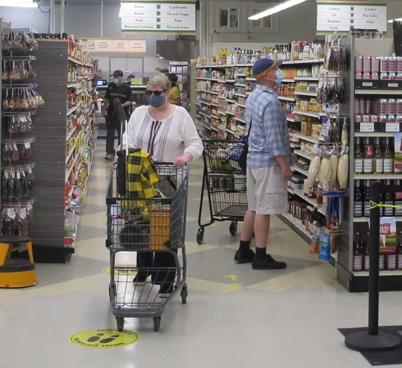 PHOTO BY: BILL GALLAGHER - Shoppers at the Hillsdale Basics Market have been cooperating with coronavirus safety precautions. So far the store has rarely had to limit the number of shoppers inside.