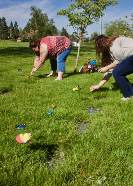 PMG PHOTO: CHRISTOPHER KEIZUR - Each grave had between 2-3 butterflies placed in honor of the child.