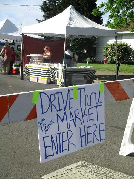 PHOTO BY DEBORAH GUINTHER - Canby Farmers Market opened Saturday with a few additions to help combat COVID-19 worries.