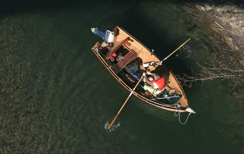 PMG FILE PHOTO - A fisherman pilots his boat below the Troutdale bridge on the Sandy River. A proposal by the Oregon Department of Fish and Wildlife would open an addition 25 miles of the river to fishing from a boat, though motors would still be limited to the portion of the river below Dabney Park.