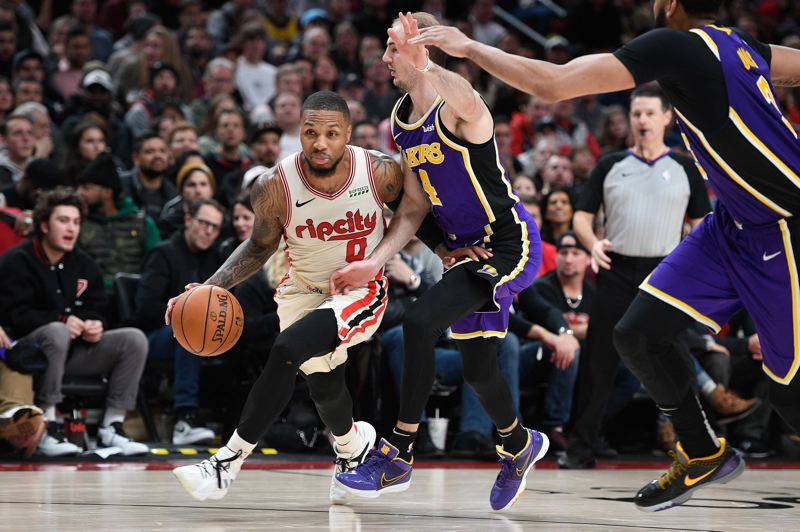 PMG FILE PHOTO: CHRISTOPHER OERTELL - Might a NBAPA poll of players, including Damian Lillard, help the league plan a timeline for resuming games?