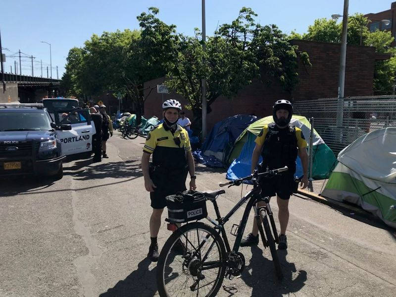 VIA PPB - Central Precinct Commander Mike Krantz, left, and another officer patroled the 500 block of Northwest Everett Street on Thursday, May 5.