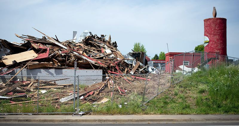 PMG PHOTO: ANNA DEL SAVIO - The barn next to the Peace Candle in Scappoose has been demolished. The Peace Candle will remain intact thanks to an easement agreement between the city and WDC, the developers building an apartment complex on the property.