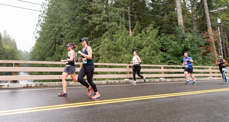COURTESY PHOTO: DAVID GRIFFITHS PHOTOGRAPHY - Runners cross over the Salmon River in the Mount Hood National Forest during the  2019 Huckleberry Half Marathon, staged by Tualatin-based Events 37. The COVID-19 pandemic has led to organizers of many races to form the Endurance Sports Coalition.