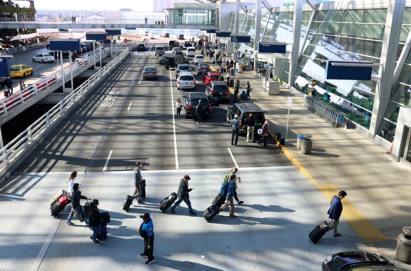 PMG FILE PHOTO - Port of Portland officials said travelers passing through PDX would have to wear face coverings. The port also will close waiting areas, asking people picking up passengers to stay outside the terminal.