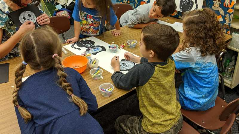 PMG FILE PHOTO - Children in an elementary school classroom work on art projects in 2019. Oregon reported its first case of a child with pediatric multi-system inflammatory syndrome on May 13. The illness is characterized as a COVID-19 related respiratory condition with symptoms similar to Kawasaki Disease.