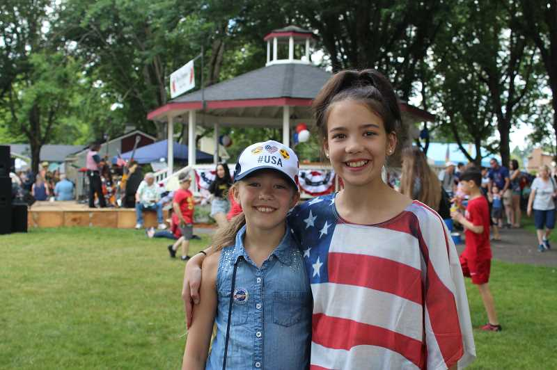 PMG FILE PHOTO: KRISTEN WOHLERS - From left, Alayna and Shylah Pittman pause for a photo at the 2019 Canby Independence Day Celebration at Wait Park. This year's event is canceled due to COVID-19 gathering restrictions.