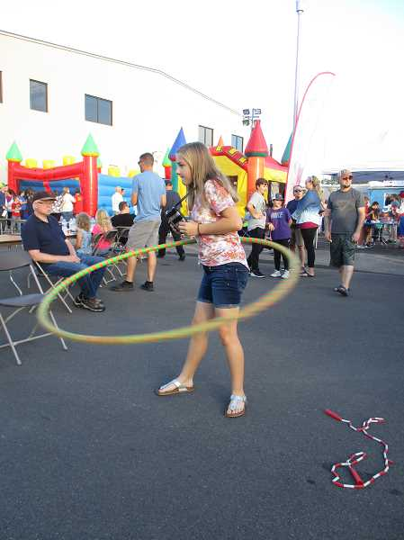 PMG FILE PHOTO: DEBORAH GUINTHER - Lydia Hesse hula hoops at Canby's Big Night Out Street Dance in 2019. This year's event is canceled, along with many more of Canby's large events.