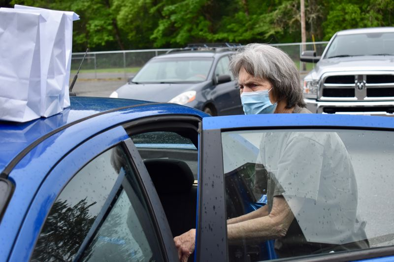 PMG PHOTO: EMILY LINDSTRAND - Estacada Meals on Wheels driver Jan Melcher prepares to bring food to community members.