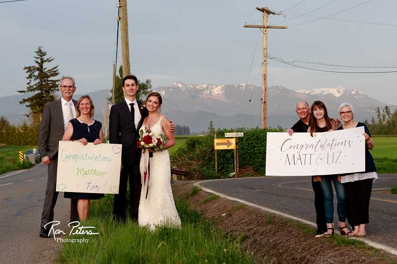 COURTESY PHOTO: RON PETERS - Matt and Liz Peters (center) met their families at the U.S.-Canada border on May 9, their wedding day. On the left are Ron and Marilyn Peters. On the right are Tim, Hannah and Heather Barton.