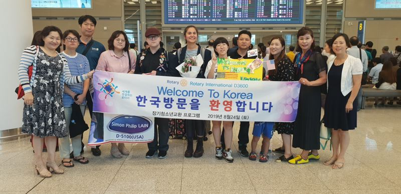 COURTESY PHOTO - Haley Budroe, middle, arriving in South Korea for her stay there through the Rotary Club of Wilsonville's exchange program.